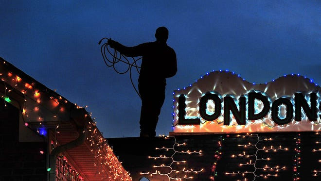 Old Hickory resident Brad Henn puts the finishing touches on his 28,000 Christmas lights this year. The lights are in honor of his daughter, London, who passed away in 2012. Brad and his family also collect toys for the Monroe Carell Jr. Children's Hospital at Vanderbilt.