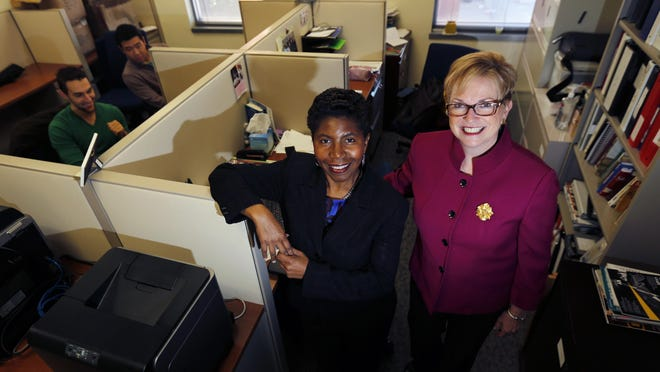 Consultants 2 Go co-owners Sandi Webster, center, and Peggy McHale, right, pose for photos in their office in Newark.