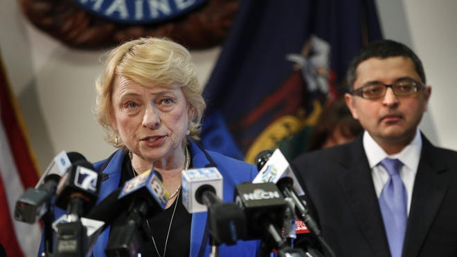 Gov. Janet Mills speaks during a news conference at the State House, on March 12, 2020, in Augusta, Maine. Dr. Nirav Shah, director of the Maine Center for Disease Control and Prevention, is at right.