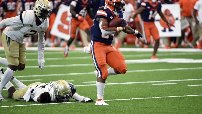 Syracuse Orange running back Sean Tucker (34) runs for a touchdown in the first quarter during a game against Georgia Tech on Saturday, at the Carrier Dome in Syracuse.