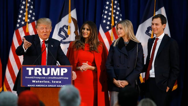 Republican presidential candidate Donald Trump, accompanied by, from second from left, wife Melania, daughter Ivanka her husband Jared Kushner, speaks during a campaign event, Monday, Feb. 1, in Waterloo, Iowa.