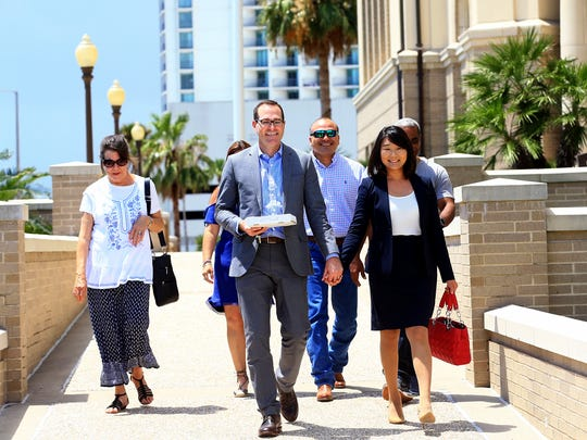 Corpus Christi Municipal Court Judge Young Min Burkett and her husband Nathan Burkett exit the U.S. Federal Courthouse after she was sworn-in as a United States citizen on Friday, July 7, 2017, in Corpus Christi.