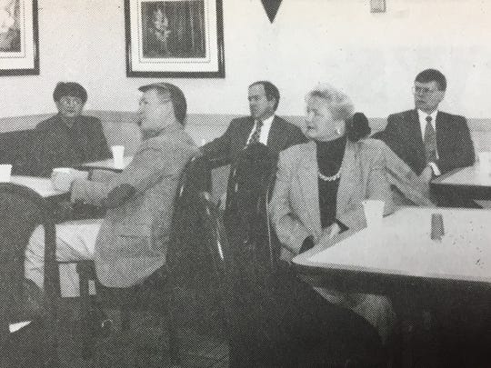 Sallie Hill, a representative of Ronald McDonald Children's Charities, spoke at a Morganfield Chamber of Commerce meeting the week of January 31st, 1996. Chamber members pictured from left are, Jane Hite, Roger Wine, Kim Humphrey, Jerry Grooms, Martin McElroy, Krystal Smith, Gary Lovell, Vann Douglas, and Ray Gorman.