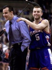Florida's Teddy Dupay jokes with coach Billy Donovan after a second-round 2000 NCAA East Regional win over Illinois at Joel Coliseum in Winston-Salem, N.C.