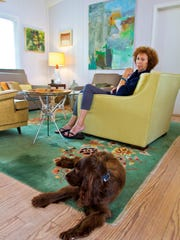 """Hollis Jeffcoat, pictured with Gracie, died April 28 following a late-stage ovarian cancer diagnosis at the age of 65.  """"A Retrospective Tribute: My Life in Paint"""" will run at Watson MacRae Gallery from Nov. 15 through Dec. 31."""