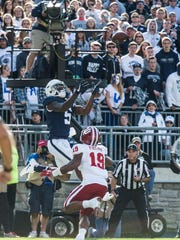 Penn State's DawSean Hamilton goes up for a touchdown pass against Indiana University's Torrence Brown as Penn State beat Indiana University 45-14 on Saturday, Sept. 30, 2017.