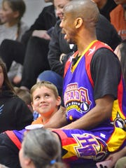The Harlem Wizards' King Arthur gets a adoring glance
