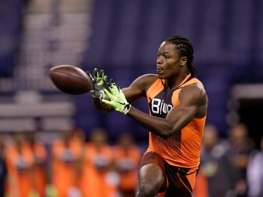 Georgia wide receiver Chris Conley runs a drill at the NFL football scouting combine in Indianapolis, Saturday, Feb. 21, 2015. (AP Photo/David J. Phillip)