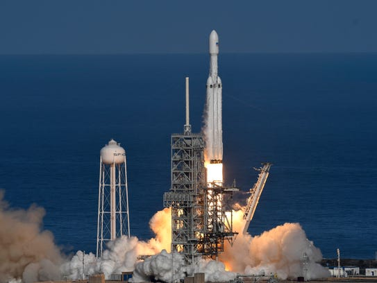 SpaceX's newest rocket, the Falcon Heavy, lifted off