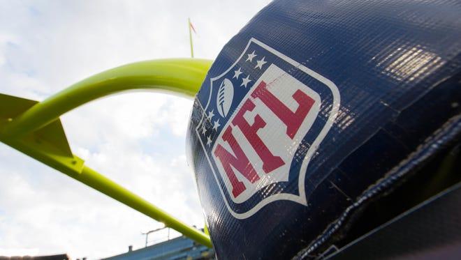 The NFL logo on goalpost padding at Lambeau Field.
