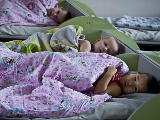 AP Kyrgyzstan Adoption Limbo