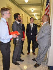 U.S. Rep. Donald Payne Jr. (right) talks with Rutgers
