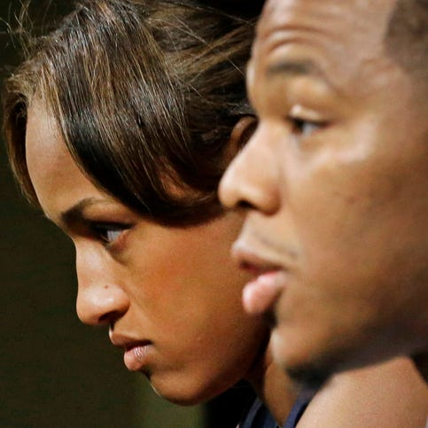 Janay Rice, left, looks on as her husband, Baltimore Ravens running back Ray Rice, speaks to the media during a news conference in Owings Mills, Md.,