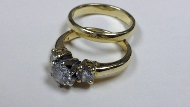 This diamond ring, valued at $1,850, and a wedding band that were placed in a red Salvation Army donation kettle outside Boston's North Station have brought in $21,000 for the charity. It said the rings, given by an anonymous widow in honor of her late husband, were accompanied by a note in which the woman said she hoped they would be sold and the money used to buy toys for children in need. Salvation Army Major David Davis said Monday, Dec. 15, 2014 that a former bell ringer offered $21,000 for the rings.