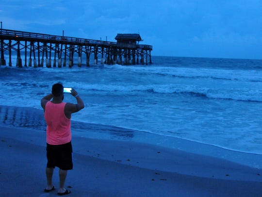 People came out at dawn to photograph the Cocoa Beach