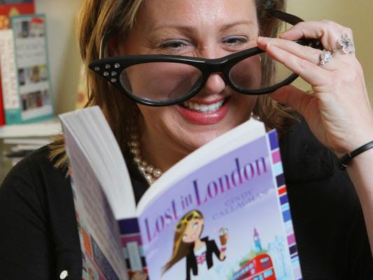 """Author Cindy Callaghan likes to use oversized glasses when does readings of her books, including """"Lost in London."""""""