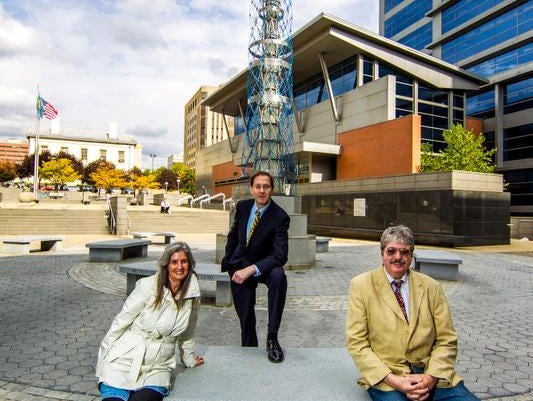 """OCT. 23, 2013: Attorney David Finger (center), John Flaherty, president of Delaware Coalition for Open Government and coalition member Bonnie Corwin consider ruling against Delaware's """"secret"""" arbitration process as a victory for the coalition, which first filed suit in 2011."""