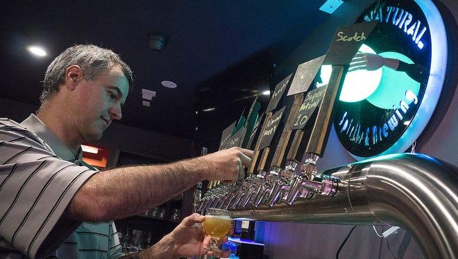 Chris Hibner draws a brew at SuperNatural Brewing and Spirits.