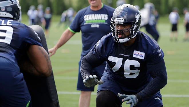 Seattle Seahawks offensive tackle Duane Brown, right, is participating in offseason workouts with the team, even as he seeks a contract extension. Teammate Earl Thomas is taking a different strategy, skipping optional offseason practices while seeking a new contract.