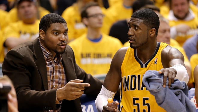 Pacers center Roy Hibbert talks to Andrew Bynum on the bench against the Atlanta Hawks in the first round of the NBA Eastern Conference playoffs, April 19, 2014, at Banker Life Fieldhouse.