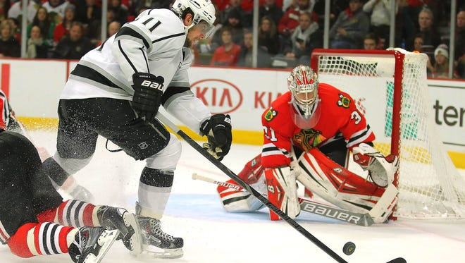 Los Angeles Kings center Anze Kopitar (11) moves in on Chicago Blackhawks goalie Antti Raanta (31) during the third period at the United Center. Chicago won 1-0.