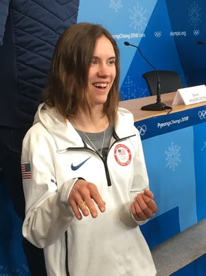 Nita Englund of Florence, Wis., answers questions during a news conference for the U.S. women's ski jumping team.