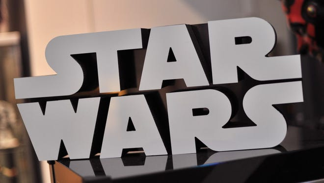 A Star Wars logo sign is seen atop a popcorn machine inside Rancho Obi-Wan, the world's largest private collection of Star Wars memorabilia, in Petaluma, California on November 24, 2015.