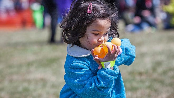 A girl gathers eggs at the South Side Church of the Nazarene's annual Easter egg drop in this file photo.