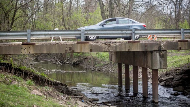 Cars drive over Delaware County Bridge 159, which carries Windsor Road at Prairie Creek Reservoir. Delaware County commissioners are planning to replace the bridge that was built in 1960.