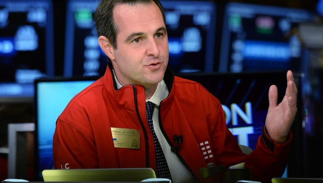 This file photo taken on December 11, 2014 shows Lending Club Founder and ex-CEO Renaud Laplanche being interviewed on TV after his company's IPO on the New York Stock Exchange in New York.