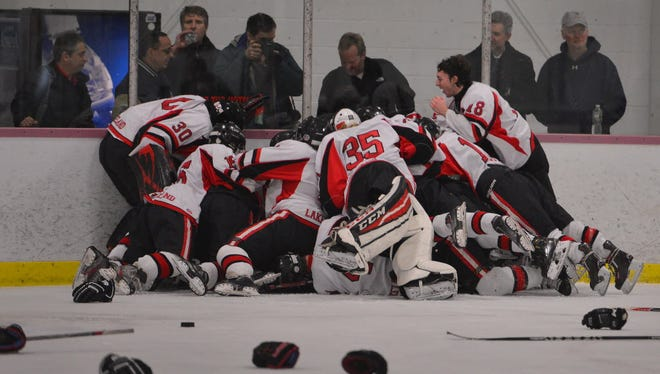 The Lakeland ice hockey team celebrates after winning their second-straight Passaic County Tournament title last January at Floyd Hall Arena on the campus of Montclair State University. The Lancers earned the top seed in this year's tournament and kick off their quest for a third-consecutive crown on Saturday in the semifinal round.
