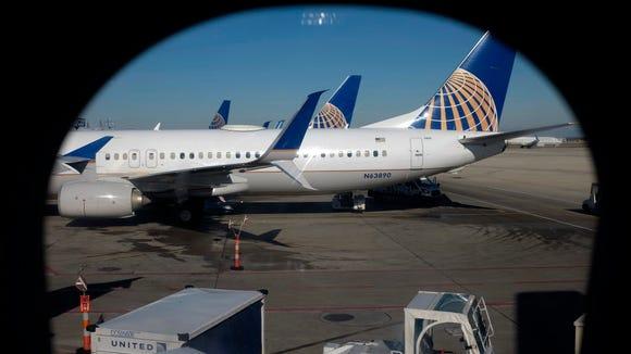 In this Nov. 22, 2017, photo taken through an aircraft