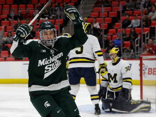 Michigan State forward Taro Hirose (17) reacts after his goal on Michigan goaltender Hayden Lavigne (30) during the first period of U-M's 6-4 win over MSU in the Great Lakes Invitational on Tuesday, Jan. 2, 2018, at Little Caesars Arena.