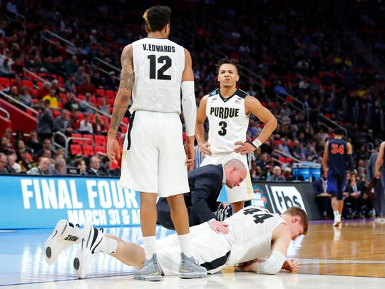 Boilermakers center Isaac Haas (44) lays on the ground after an injury in the second half against the Cal State Fullerton Titans  in the first round of the 2018 NCAA Tournament at Little Caesars Arena.
