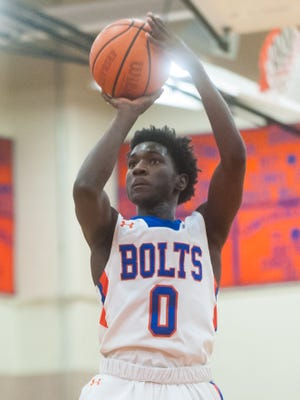 Millville guard Rynell Lawrence (0) takes a shot against Kingsway in the first round of the NJSIAA South Jersey Group IV Tournament at Millville High School on Monday, February 27.