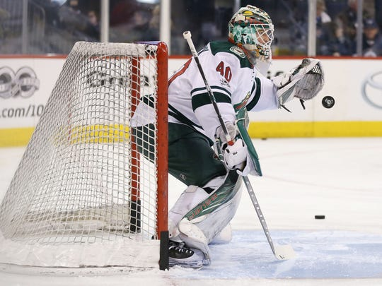 Minnesota Wild goalie Devan Dubnyk makes a save during warmup prior to the game between the Winnipeg Jets and the Minnesota Wild at MTS Centre.