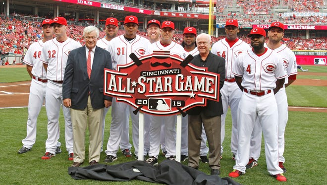 Current and former Cincinnati Reds All-Stars line up with the 2015 All-Star Game logo along with Reds president and CEO Bob Castellini, front left, and general manager Walt Jocketty, front right, on Aug. 6.