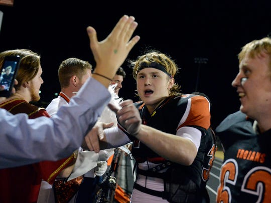 York Suburban's Collin Mailman, center, celebrates with students after a YAIAA football game Friday, Nov. 6, 2015, at York Suburban. York Suburban defeated Eastern York 30-7.