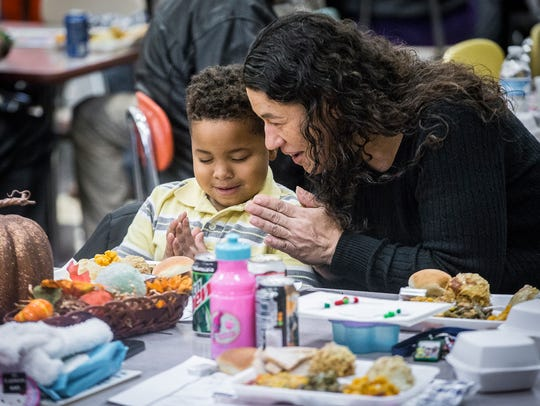 Zakari Echols prays with his grandmother, Doris Shelton,