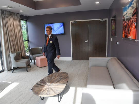 Gary Cohen, general manager of The Abernathy, walks in the VIP room in the new hotel near Memorial Stadium in Clemson on Wednesday.