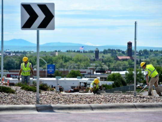 United Materials finishes up the car roundabout at Smelter Avenue and Division Road.  TRIBUNE PHOTO/RION SANDERS United Materials finishes up the car circle on Smelter Avenue Northwest. TRIBUNE PHOTO/RION SANDERS