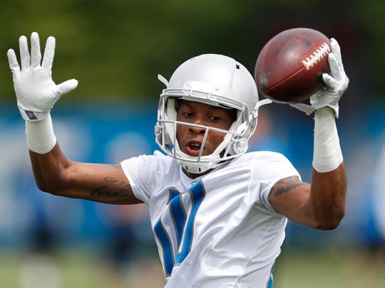 Detroit Lions wide receiver Teo Redding (10) turns