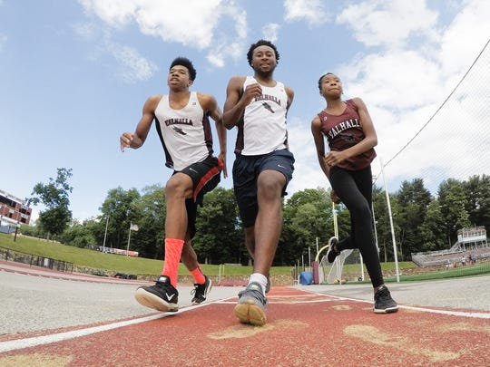 Valhalla High School long jumpers Ethan Bartlett, left,