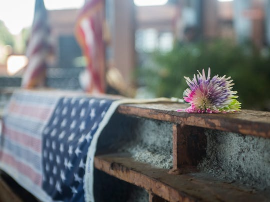 A rainbow colored carnation was placed on a beam recovered from the World Trade Center rubble during the 15th anniversary.