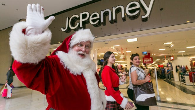 Santa Claus greets shoppers outside the J.C. Penney store at the Glendale Galleria shopping mall in Glendale, Calif., in 2014