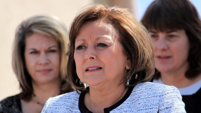 New Mexico Gov. Susana Martinez is flanked by advocates as she talks about opioid and heroin overdoses in New Mexico during a bill signing ceremony at a substance abuse treatment center in Albuquerque, N.M., on Thursday, April 6, 2017. Among other things, the bill signed by Martinez requires all state and local law enforcement officers to be equipped with an overdose antidote kit.