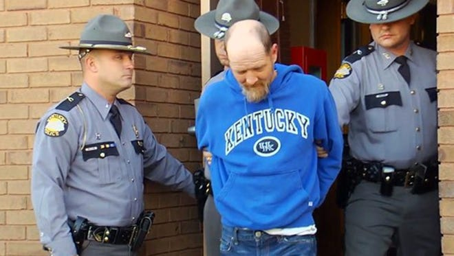In this image taken from video, Kentucky State Police escort Timothy Madden from State Police Post 3, Friday, Nov. 20, 2015, in Bowling Green, Ky. Madden was arrested Friday and charged with murder and sex crimes in the death of Gabriella Doolin, a 7-year-old Kentucky girl whose body was found in a creek minutes after she disappeared during a football game Saturday night, Nov. 14.