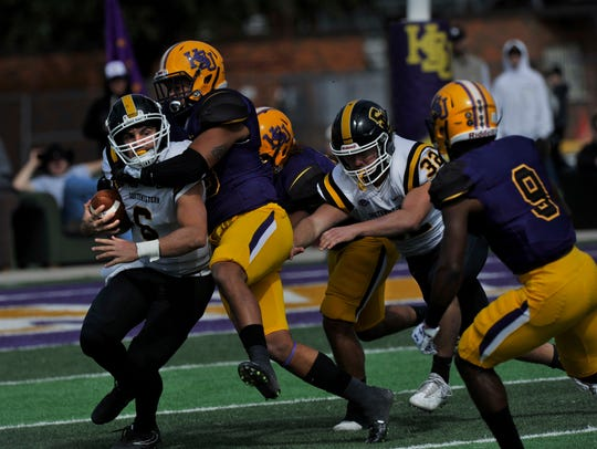 Hardin-Simmons University defensive players sack Southwestern