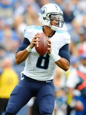 Sep 27, 2015; Nashville, TN, USA; Tennessee Titans quarterback Marcus Mariota (8) drops back to pass during the first half against the Indianapolis Colts at Nissan Stadium. Mandatory Credit: Christopher Hanewinckel-USA TODAY Sports