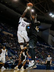 Tacko Fall on defense against Connecticut center Amida